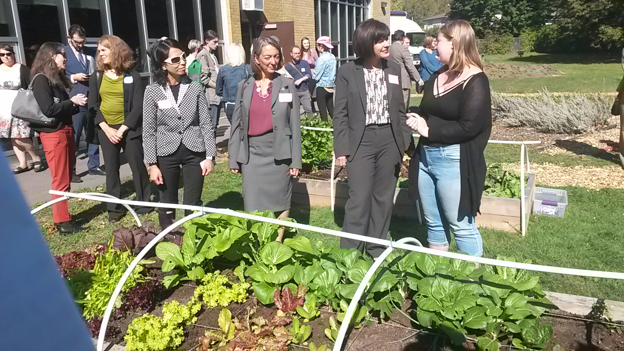 CPHO Dr. Theresa Tam, MP Julie Dabrosin and Minister Ginette Petitpas Taylor learn about the incredible garden at Norman Johnston Alternate School from student Maddie Richards.